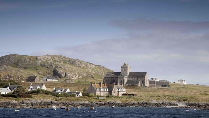 ancient abbey against coastline